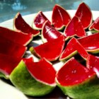 Sliced Watermelon Jell-O(R) Shots - Cute little watermelon-slice shots made with watermelon-flavored gelatin, vodka, and fresh lime peels pack a kick, but you can make a fun kids' version by leaving out the vodka and adding a cup of cold water.
