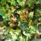 Sweet and Tangy Broccoli Salad - Sweet and tangy mayonnaise makes a simple dressing for this broccoli salad with onion, raisins, and crispy bacon.
