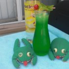 Bullfrogs - A green slushy cocktail is served in a glass with a splash of soda for a refreshing vodka drink. Freeze the mixture 1 to 3 days ahead of time and just scoop into glasses.