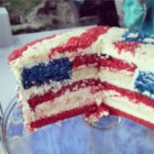 American Flag Cake - Unfurl the red, white, and blue with this beautiful, easy, and patriotic flag cake perfect for the 4th of July, Memorial Day, or any favorite occasion. Assemble and frost the pretty cake and wait for the oohs and ahhs!