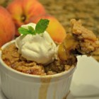 Sheila's Peach Cobbler with Pecans - Homemade peach cobbler made with fresh sliced peaches and pecans is topped with a sweet, buttery crust and baked in an old-fashioned cast iron skillet. Try it with praline ice cream for a special treat.