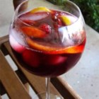 Indian Summer Raspberry Peach Sangria - Red wine, peach schnapps, and raspberry-flavored soda water are the primary ingredients in this sangria punch with fresh fruit and fruit juices.