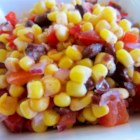 Black Bean and White Corn Salad - A colorful salad combines white corn with black beans, bright red tomatoes and red bell pepper, and green cilantro for a quick, pretty, and flavorful dish. Add diced avocado at the last minute if you like. The dressing is just fresh lime juice and a hint of tequila.