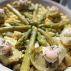 French Shrimp Salad - What a great luncheon salad, especially when fresh asparagus and shrimp are at their peak. The salad is composed. First with the shrimp and asparagus mixed with a bit of mayonnaise. Then with sieved eggs, whole stalks of asparagus, and finally artichoke hearts marinated in a French dressing.