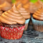 Smooth Double Chocolate Frosting - Semisweet and white chocolate chips are melted and beaten with cream and sugar creating a smooth and creamy chocolate frosting that always gets rave reviews.