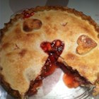 Rhubarb Cherry Pie - The rhubarb is sliced, stirred into cherry pie filling and sugared. This yummy filling is poured into a prepared crust, topped with a second circle of pastry, and baked in a hot oven until bubbly and golden.
