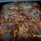 Rice Lasagna - Mozzarella cheese, cottage cheese, ground beef, and spaghetti sauce are layered with cooked rice in this easy meal.
