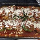 Stuffed Green Peppers - Peppers stuffed with black beans, rice and cheese, then topped with tomato sauce.  Add your favorite herbs and spices to jazz it up!  A great way to use left over rice.  Use any cheese you choose.