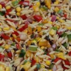 Orzo and Wild Rice Salad - This wonderful salad of pasta, currants, and vegetables is dressed with a tangy vinaigrette.