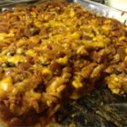 Throw Together Mexican Casserole - Ground beef, olives, egg noodles, corn, taco sauce and seasoning give this throw together casserole it's South-of-the-border flavor.