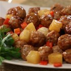 Tiffany's Sweet and Spicy Meatballs - Prepared meatballs are baked with bell peppers and pineapple in a sweet, hot and sour sauce for an easy meal with little clean up.