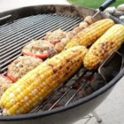 Corn on the Grill - These ears of corn will keep you coming back to the grill for more of this sweet-and-spicy garlic-lover's dream.