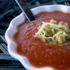 Fresh Tomato Zucchini Soup - Pureed tomatoes and sauteed zucchini are stewed together into a delicious summertime soup!