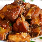 Vietnamese Caramelized Pork - Pork, green onions, and green chiles are tossed in hot caramelized sugar until golden brown. The sugar melts into a sweet and savory sauce.