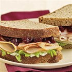 Cranberry Thanksgiving Turkey Sandwich - Sliced Maple Honey Turkey makes a great sandwich on whole wheat bread with mayo and cranberry sauce.