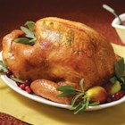 Maple Basted Roast Turkey with Cranberry Pan Gravy - Roast turkey is basted with maple syrup for a sweet glaze; cranberry juice and sweetened dried cranberries bring a sweet-tart fruit dimension to the pan gravy.