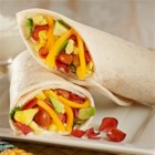 Turkey Bacon Breakfast Burrito - Start off your day with a hearty burrito packed with chili beans, eggs scrambled with crumbled bacon, shredded cheese, and more!