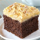 German Chocolate Cake - Make a great German Chocolate Cake with this easy recipe. The coconut and pecan frosting is deliciously dreamy.