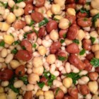 Lebanese Bean Salad - This Lebanese-inspired three bean salad combines fava beans, chickpeas, and white beans with lemon juice and parsley for a refreshing side dish perfect for lunch or picnics.