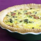 Au Gratin Quiche - This broccoli quiche can be in the oven with just 15 minutes of prep time. Mix it up by substituting your favorite fresh vegetable or by adding garlic.