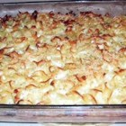 Lokshin Kugel (Noodle Pudding) - A side dish to be served with chicken. Egg noodles, sauteed onions, eggs and bread crumbs are combined and baked.