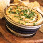 Super Easy Hummus - Garbanzo beans, garlic, cumin, salt, olive oil, and lemon juice are all standards in hummus making. Try a few drops sesame oil for something new.
