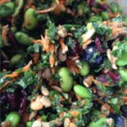 Super Summer Kale Salad - This kale salad recipe delivers a big bowl of vegetables, fruits, nuts, and seeds for a filling potluck favorite.