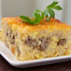 Southern Grits Casserole - Grits are a must for breakfast in some parts of the world. They are baked with sausage, eggs, and cheese in this fantastic breakfast casserole.