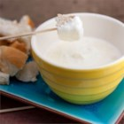 Parmesan Fondue - You can have a warm, mild, and creamy fondue on your table in just moments by melting Neufchatel cream cheese and Parmesan cheese in milk.
