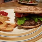 Firecracker Burgers - This is a great, easy burger recipe. The ground beef is combined with green chile peppers and beef bouillon. This makes them very moist and flavorful. Serve on hamburger buns with your favorite fixings.