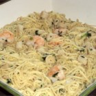 Savory Sea Scallops and Angel Hair Pasta - Lightly-cooked and tender sea scallops, served in the simplest, quickest sauce of lemon juice, butter, parsley, and fresh basil, are served over angel hair pasta for an elegant but easy dish. Add cream or Parmesan cheese if you like.