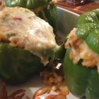 Spicy Vegetarian Stuffed Peppers - These vegetarian stuffed peppers have plenty of hot peppers mixed with rice and Monterey Jack cheese for a spicy vegetarian side or main dish. Serve with sour cream and salsa.