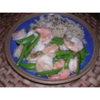 Stir-Fried Shrimp with Snow Peas and Ginger - Shrimp are stir-fried with snow peas in a tantalizing sauce of chicken broth, rice wine, soy sauce, garlic, and ginger.