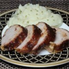 Apple Butter Pork Loin - Roasted pork loin, seasoned with spiced apple butter and roasted in apple juice, makes a great Sunday dish.