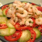 Shrimp, Jicama and Chile Vinegar Salad - Tomatillo and tomato slices are topped with crisp jicama and shrimp. The dressing is made with seasoned rice vinegar, minced jalapeno, and sugar for a spicy, sweet, and tangy flavor.