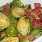 Roasted Brussels Sprouts with Cranberries - Roasted garlic, cranberries, and prosciutto give roasted Brussels sprouts an added richness for the holiday dinner table.