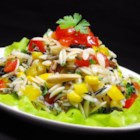 Bellepepper's Orzo and Wild Rice Salad - Orzo and wild rice are tossed with pecans, almonds, and a colorful variety of veggies in a homemade vinaigrette for a crowd-pleasing salad.