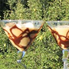 Chocolate Martinis For Two - These chocolate martinis are served in martini glasses coated with chocolate syrup and garnished with maraschino cherries. Use the cherries to slowly stir the chocolate syrup into the drink!