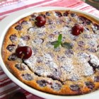 Brandied Cherry Clafouti - Clafouti is a traditional French dessert with brandied cherries baked with a custard topping creating a warm and sweet dessert that goes well with a cup of tea.
