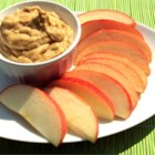 Peanut Butter Yogurt Dip - You can quickly and easily make this delicious dip for fruit with just peanut butter, vanilla yogurt, and cinnamon.