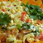 Confetti Corn Salad - This quick and tasty salad uses prepared ranch dressing with a mixture of corn, tomato, bell pepper, celery, and onion.