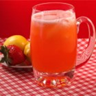 All Natural Strawberry Lemonade - Homemade strawberry lemonade is easily prepared with fresh strawberries, lemon juice, and sugar for a refreshing summer drink.