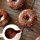 Chocolate Hazelnut Frosted Donuts - Devil's food cake donuts are dipped in chocolate hazelnut spread and sprinkled with chopped nuts.