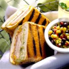Grilled Turkey Cuban Sandwiches - Grilled turkey breast, ham, cheese and pickles in a panini-style sandwich.