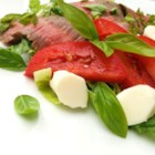 Caprese Salad With Grilled Flank Steak - Top your Caprese salad with grilled flank steak for a quick and easy summertime dinner.