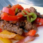 Spicy Beef Fajitas - Thinly sliced beef, bell peppers, and red onion are stir-fried with fajita seasoning in this family-pleasing meal. Anaheim chile peppers are mild enough for kids.