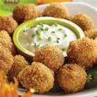Peanut Butter Jalapeno Poppers - You get all the flavors of your favorite jalapeno poppers in these spicy, panko-breaded pan-fried cheese balls served with sour cream and chives.