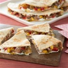 Creamy Jalapeno and Pulled Pork Quesadilla - Spicy cream cheese, pulled pork, and veggies make quick and tasty quesadillas.