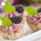 Easy Fruit Tarts - Blackberries have the starring role in this tasty recipe for mini cream cheese pastries made with blackberry preserves and topped with fresh or frozen blackberries.