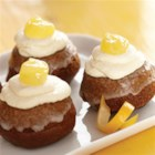 Lemon Gingerbread Mini Cakes - Nothing goes with gingerbread like the taste of lemon, and nothing will disappear faster than these cute mini gingerbread cakes with a fluffy lemony topping and a dollop of lemon curd.